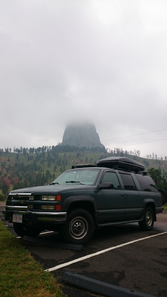 Boris waiting out the rain at Devil's Tower in Wyoming.