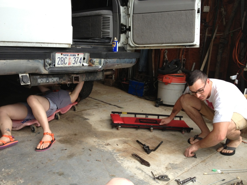Corinne fixing brake lines.