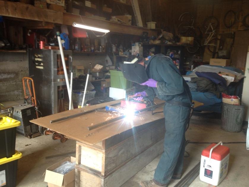 Welding the frame for the solar panels.