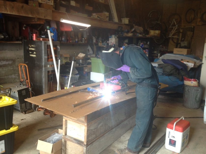 Welding the frame for the solar panels.