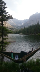 Relaxing in the hammock as the boy fish in Rocky Mountain National Park.