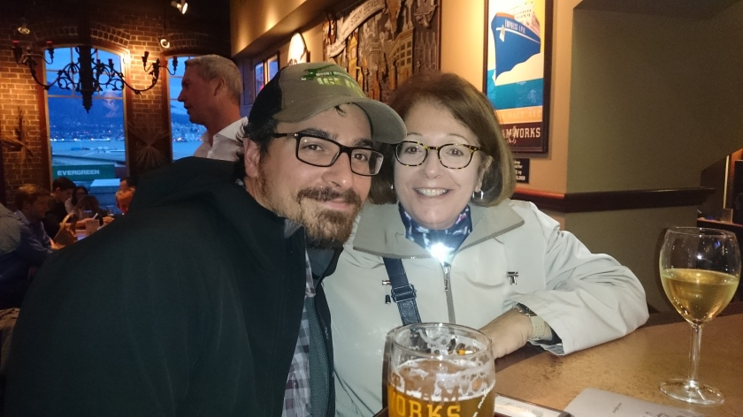 Mother and son enjoying beverages at Steamworks brewery in Vancouver.