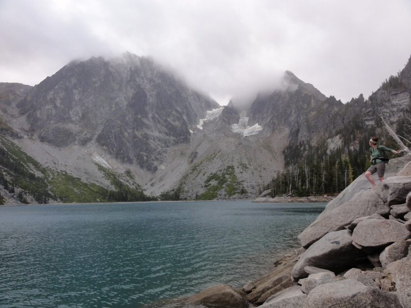 Rainy day hiking in the enchantments. Joanna stares longingly at Dragontail peak in the background.