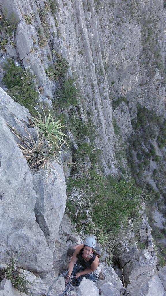 Joanna enjoys the vegetated cliffs.