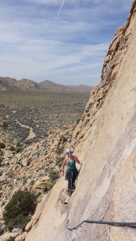 Joanna leads the traverse/downclimb to start pitch 3 of Dappled Mare (5.8).